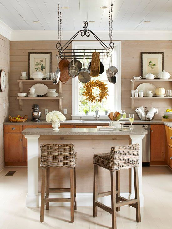 Love the planked backsplash and open shelving with art and white dinnerware
