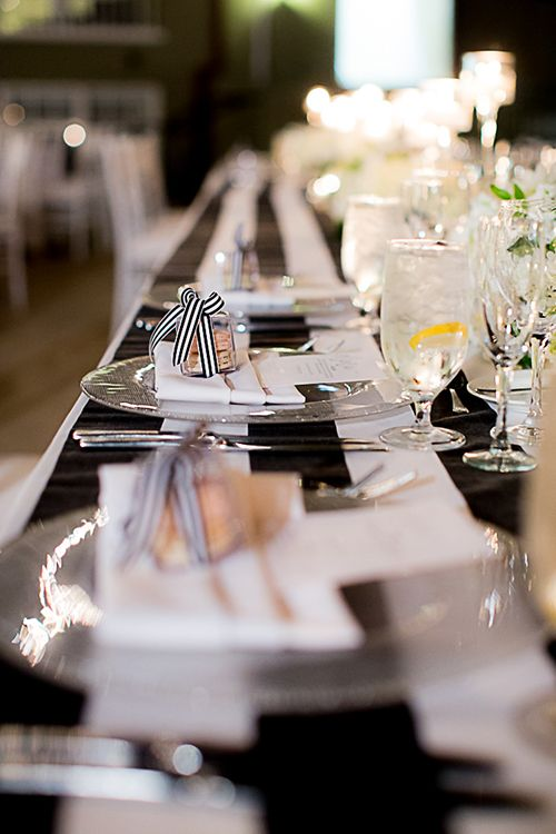 Black-and-white striped tablecloths   @cloveandkin   Brides.com