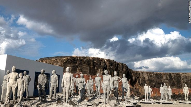 This sculpture, photographed before submersion, involves 35 walking figures and is called The Rubicon.  Europe's first underwater museum is opening in waters off the Spanish island of Lanzarote.  el primer museo submarino de europa se abrirá en 2017 en Lanzarote