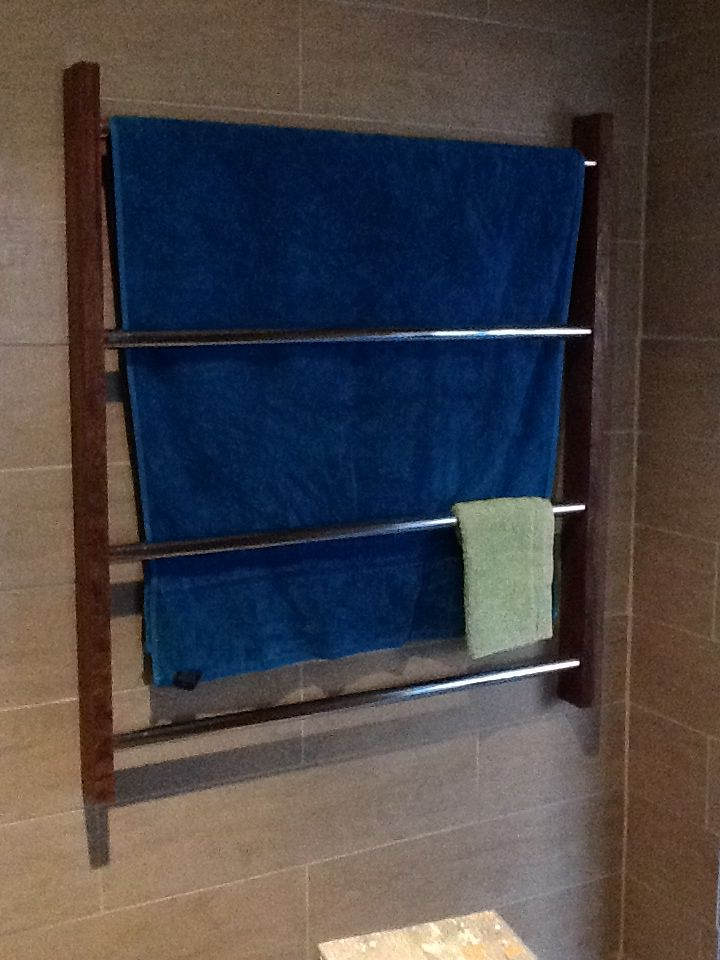 Towel rail made of same timber as window architrave. We made it wide enough for our towels.