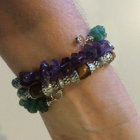 Amethyst,Tigers eye, aventurine wrap bracelet This is a 3 row bracelet made on memory wire. It has all natural gem stones of aventurine Tigers eye, and amethyst. It has lots of Tibetan silver also. Handmade by me.  NWOT.  BUNDLE TO GET THE BEST VALUE Jewelry Bracelets