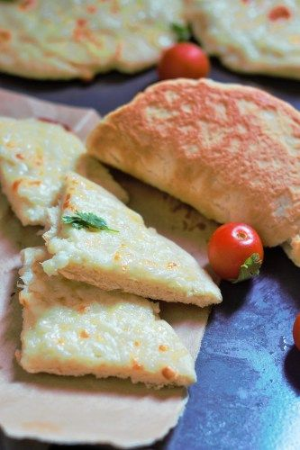 Cheese Manakish Recipe - A simple and tasty Arabic Flat Bread topped with delicious cheese and baked to perfection.