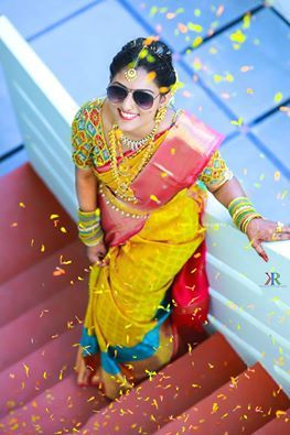 South Indian bride. Gold Indian bridal jewelry.Temple jewelry. Jhumkis. Yellow and pink silk kanchipuram sari.Braid with fresh jasmine flowers. Tamil bride. Telugu bride. Kannada bride. Hindu bride. Malayalee bride.Kerala bride.South Indian wedding.