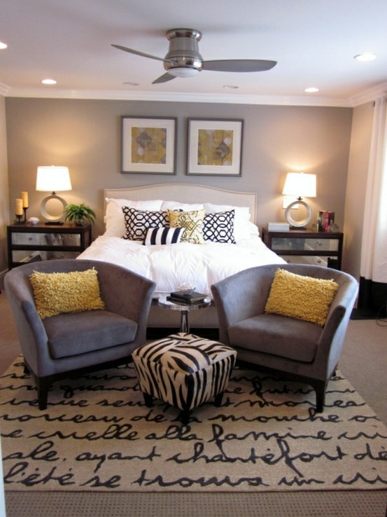 Grey and yellow bedroom. Hang white curtains next to sliding doors on the track (white ikea curtains with ruffles sown to bottom) Mirror tiles on night stands. White/mirror/crystal lamp bases with white shades. White pillows, white duvee, gold sheets, gold, yellow and black pillows.