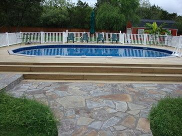 Oval above ground pool with deck - traditional - swimming pools and spas - other metro - by The Above Ground Pool & Spa Company