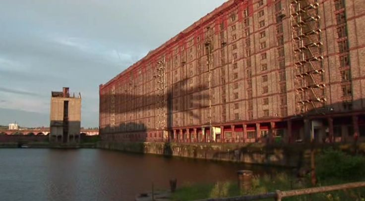 "Frame from the video ""LEFT BEHIND"" (UK 2009, 2'20'') by Monika Koeck, architecture by Anthony George Lyster. /// ""As we follow the shadow of a mysterious dancer along brick walls, an emotional exposé of Liverpool's famous Tobacco Warehouse (Liverpool, 1901) is revealed by means of an abstract narrative. An industrial building that today lies empty, regardless of its historical significance, in a vast and abandoned dock landscape. (…)"" /// #architecture #video #image @WeAreImage"