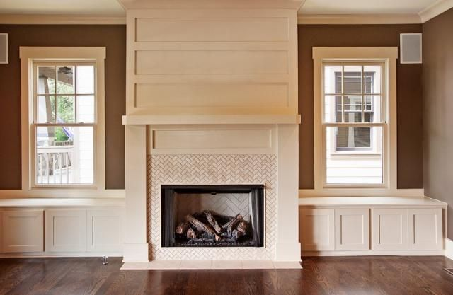 Aspen mantle / built ins. Smaller windows with shelves for built ins and drawers at bottom
