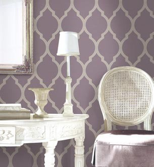 Love the purple and metallic wallpaper. Master bedroom accent wall.