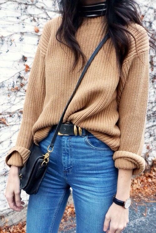 tucked in tan oversized sweater , black and gold leather accessories, love.