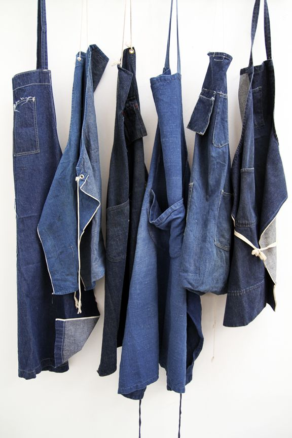 A bunch of selvedge denim aprons, brass grommets, bar-tacked, pocketed and double stitched....