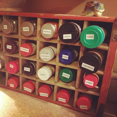 turn a vintage soda crate on its side to hold containers holding beads and other little things