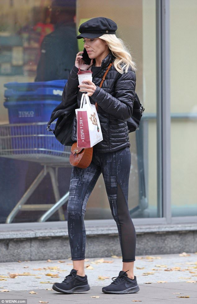 Ready to work: Clutching onto a coffee from Pret, the star looked to be trendy in her spor...
