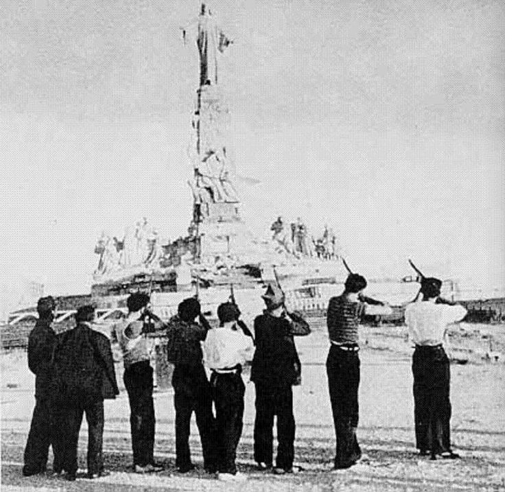 "The ""Execution"" of the Sacred Heart of Jesus by militiamen at Cerro de los Ángeles near Madrid, on 7 August 1936.   This was symbolic retaliation for the Church's considerable political role in the Spanish Civil War and reaction to the Church's systematic oppression of Spaniards. - See more at: http://theholyprepuce.tumblr.com/post/9376201227/the-execution-of-the-sacred-heart-of-jesus-by"