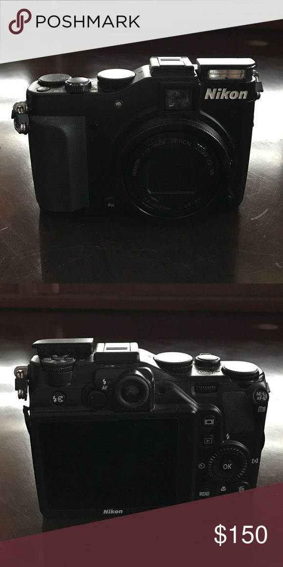 Nikon Coolpix P7000 Great Camera for beginners to Intermediate. nice photo and video quality. This is a great deal. Wall charger included. Nikon Accessories