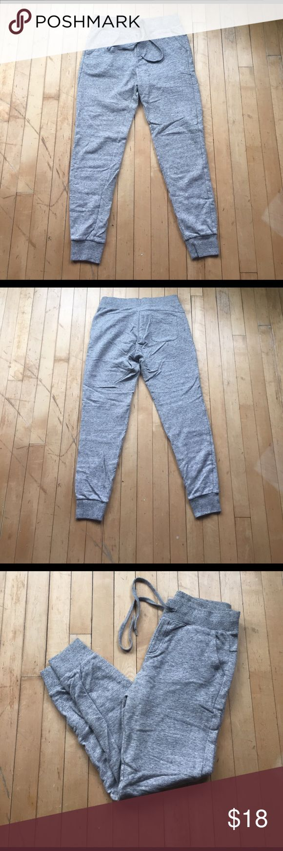 Uniqlo Japan gray heathered jogger sweatpants Gently used, very sturdy jogger sweatpant.  No interior tag, but size is small/xs. Terry cloth-like interior. Uniqlo is a Japanese brand that has recently begun appearing in the USA. Uniqlo Pants Track Pants & Joggers