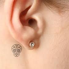 Resultado de imagen para tattos femeninos detras de los oidos