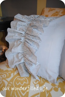 Just an easy ruffle down the front...or, what about making a ruffled band w/ elastic to put around the bed pillow instead of shams?