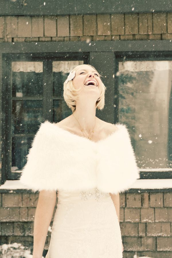 Bride in the snow wearing a winter wedding faux fur coverup. Photos By:Jennifer Eileen