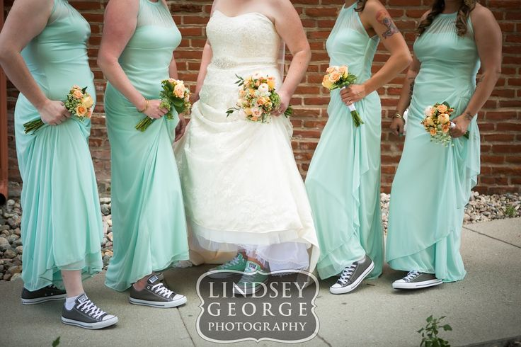 Bridesmaids and bride wearing chucks Chuck Taylor Converse fun and comfortable wedding shoes - click to view full gallery