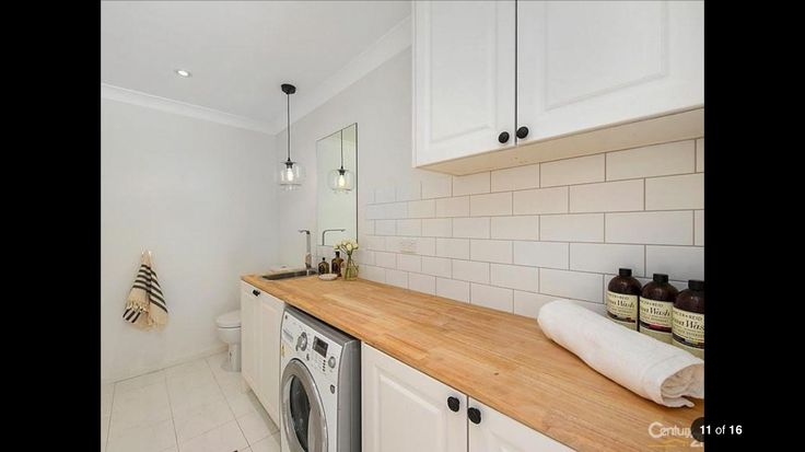 White laundry with wooden bench tops. House in Sydney Australia.