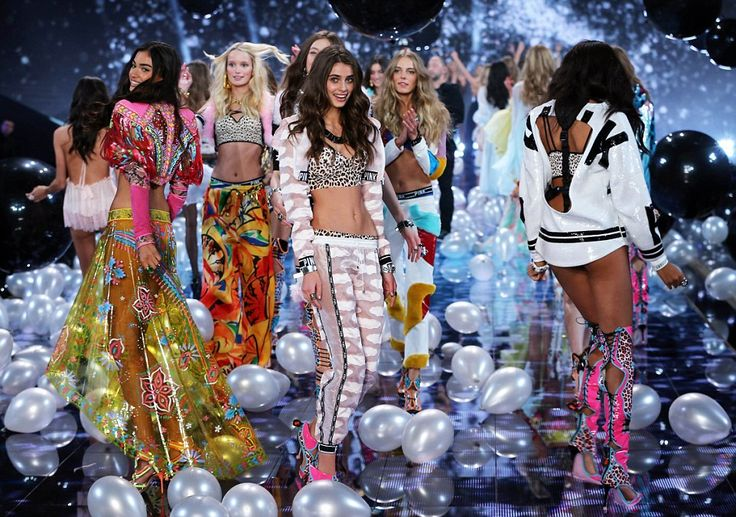 Working it: All the models clamoured together on the stage, showing off their tremendous figures and equally-stunning outfits