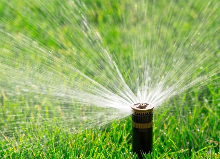 To winterize your sprinkler system, unhook and drain the feeder line from the water supply, then use an air compressor to blow any remaining water out of the system.