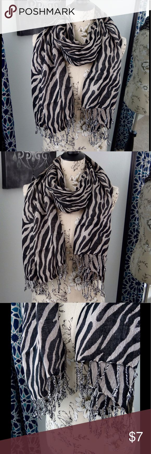 Grace Adele zebra scarf Grace Adele zebra scarf.... information coming soon! Grace Adele Accessories Scarves & Wraps