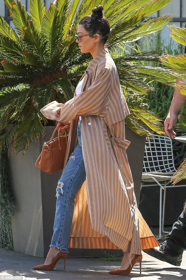 Stylish: Kourtney Kardashian sported quite the hip ensemble on Thursday as she stepped out...