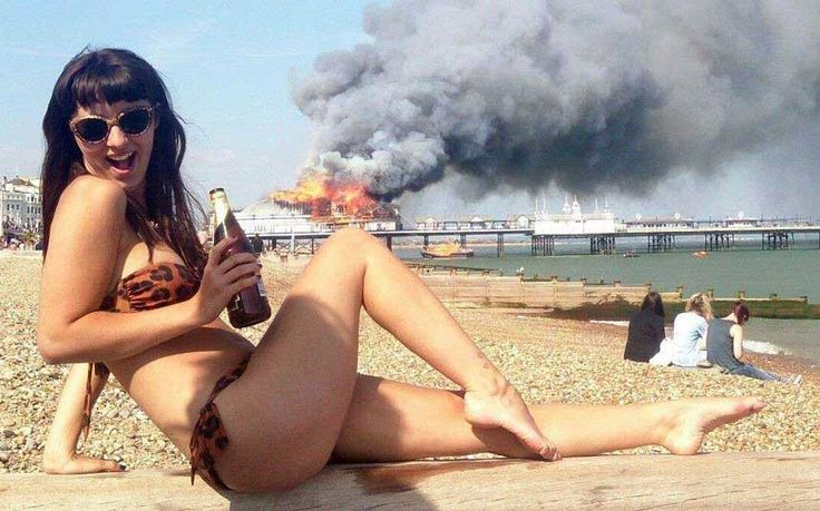 Student defends posing for beach photo during Eastbourne Pier fire - Telegraph