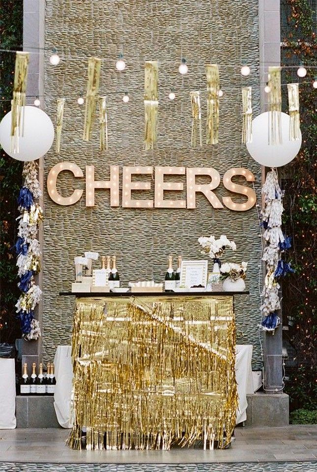 Hang a marquee sign above your champagne bar to complete your NYE party theme.