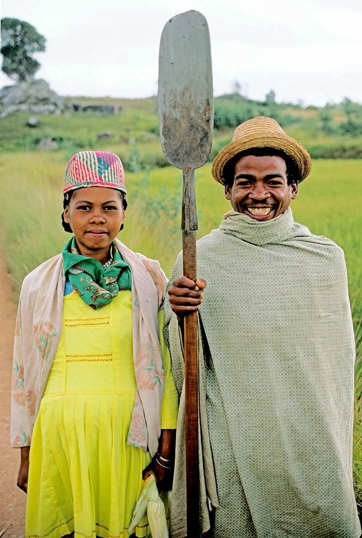 The farmers of Madagascar play a significant role in the country's economy. They grow, harvest and transport exotic crops to the markets to sell and support their families. This photo in particular reminded me of the classic American painting of the farmer holding a pitch fork and his wife standing next to him.