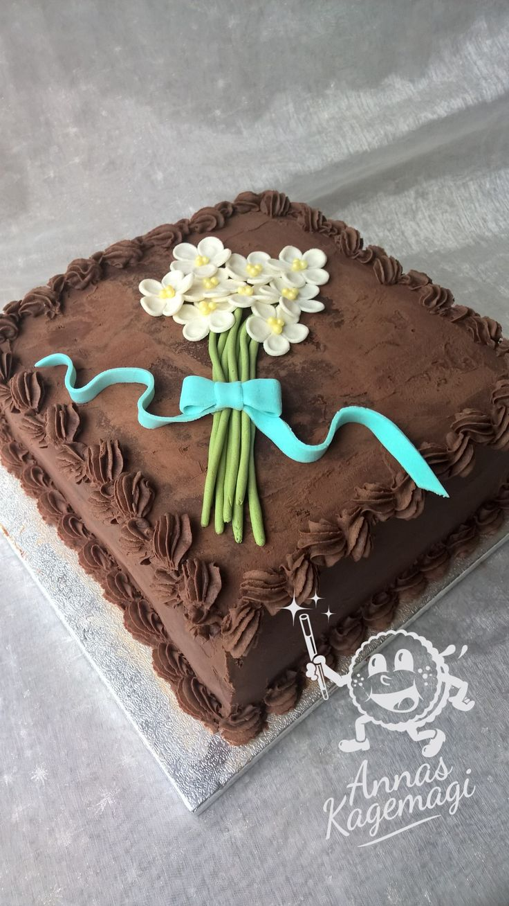 Mudcake with ganache and marzipan flowers on top.