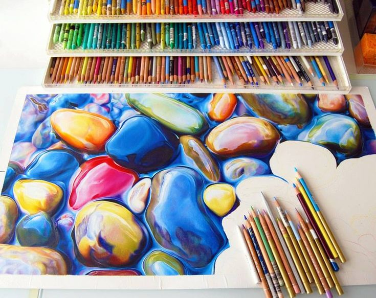 Not Your Average Drawing of a Rock: Colorful Riverbeds Drawn with simple colored Pencil by Ester Roi. She uses a heated drawing pad that she invented to melt the wax in careful steps as she draws.