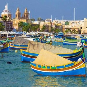 """*365 WONDERS OF THE WORLD: #88*   Marsaxlokk is the main fishing village for Malta. It's colourful and filled with Maltese spirit.Famous for its big Sunday fish market and its many decorative """"eyed"""" painted boats called Luzzus.   Book flights>>  http://www.travelstart.co.za/lp/malta/flights  #365wondersoftheworld #malta #europe"""