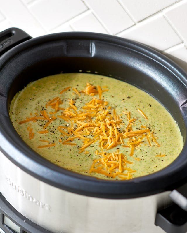The Pioneer Woman (Ree Drummond) Crockpot Broccoli Cheddar Soup Recipe. Looking for recipes and ideas for weeknight dinners and meals? Soups are perfect comfort food for cold weather! This vegetarian broccoli cheese soup cooks in a crock pot or slow cooker. So easy, and a lot like the one they serve at Panera! Low carb and so delicious. You'll need frozen broccoli, chicken stock, onion, carrots, cream of celery soup, seasoned salt, velveeta, sharp cheddar cheese.