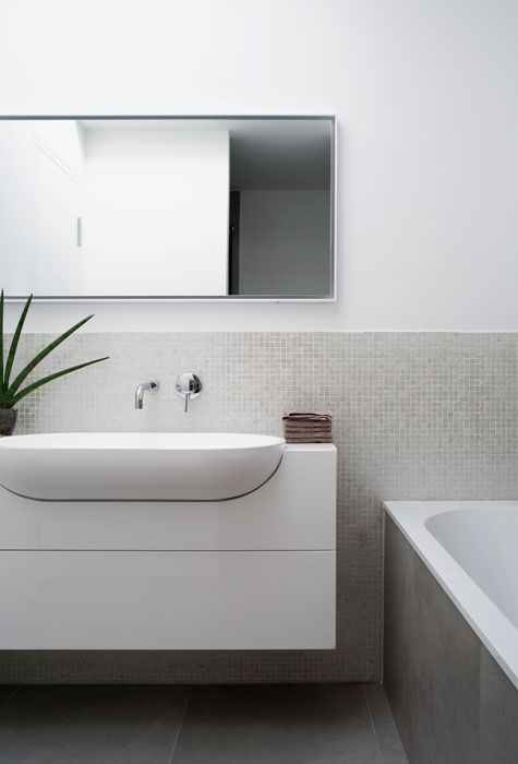 Semi-recessed basin with shallow vanity is great for narrow bathroom