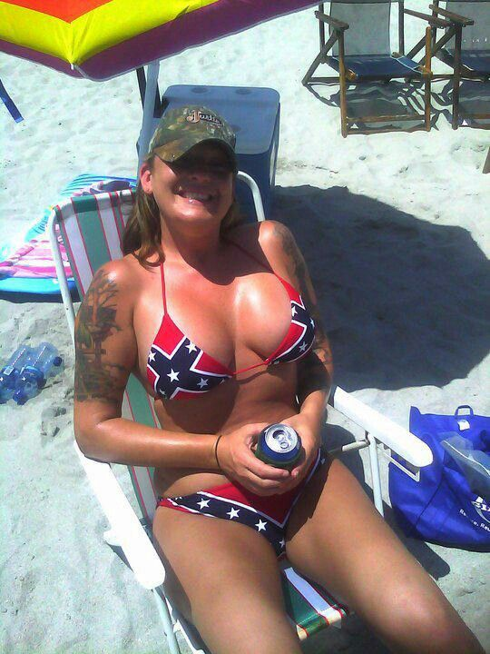 The holy trinity of hillbilly land: -camo hat -rebel flag bikini -can of beer in hand.