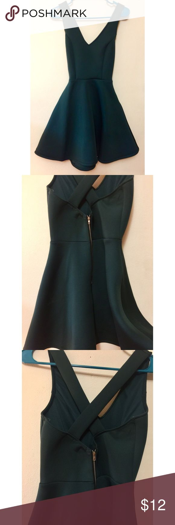 Charlotte Russe - Emerald Dress Beautiful dress only worn once for Christmas dinner. This dress is actually really interesting! The material is soft and foam-like which makes the skirt of the dress stay flared out.  Very comfortable dress. Cute criss cross in the back. Zipper located in the back. Charlotte Russe Dresses Mini