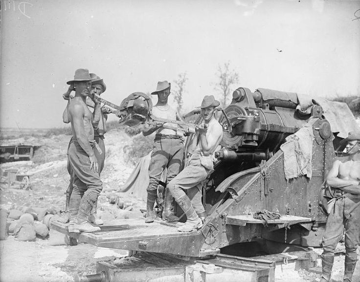 "BATTLES SOMME 1 JULY - 18 NOVEMBER 1916 (Q 4081)   Battle of Pozieres Ridge. Australian gunners serving a 9.2"" howitzer. They are stripped to the waist owing to the hot weather. Fricourt, August 1916."