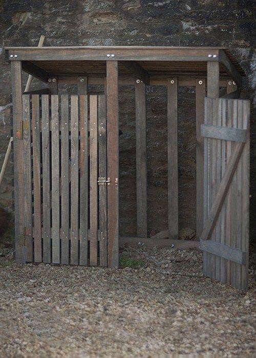To hide those unsightly garbage cans. ...Double Wooden Wheelie bin storage at Garden Trading. UK. #garden #garbage