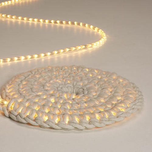 A carpet that gives light... A light rope inside of a crocheted case