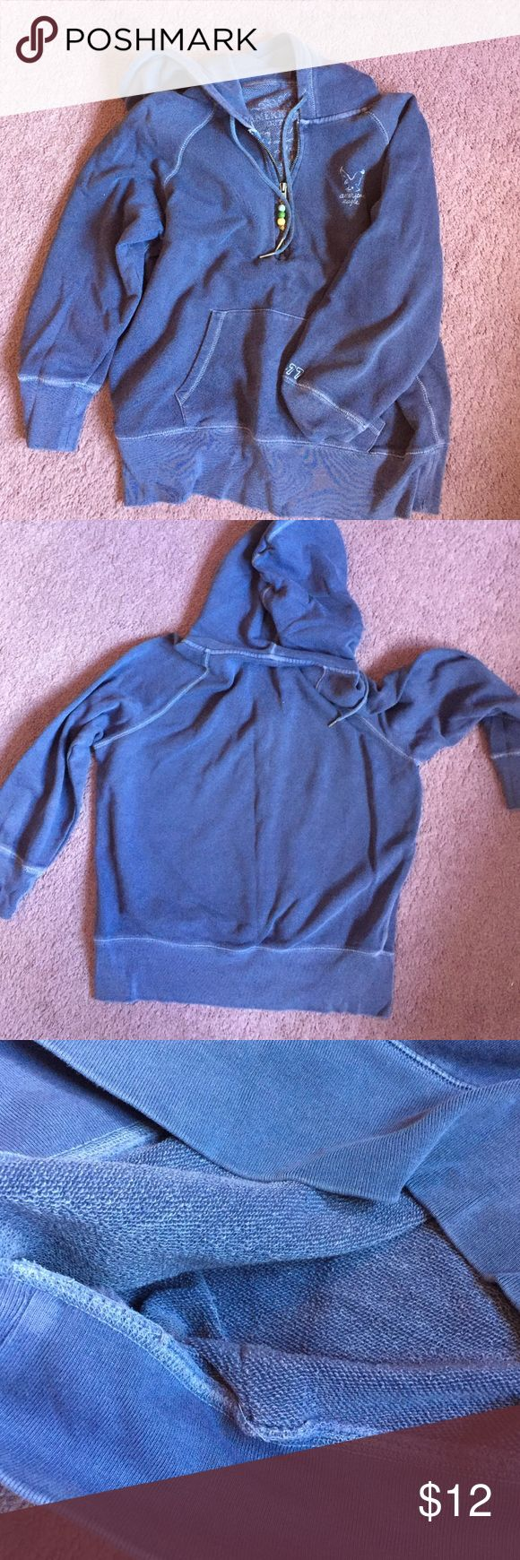 American eagle sweatshirt Bluish purple color (mostly blue) sweatshirt from American eagle outfitters. The inside is perfect for a cool summer night or warm fall. Zipper works perfectly. Small stain on the right cuff towards the hand as seen in the last picture. Other than gat it is in great condition! American Eagle Outfitters Tops