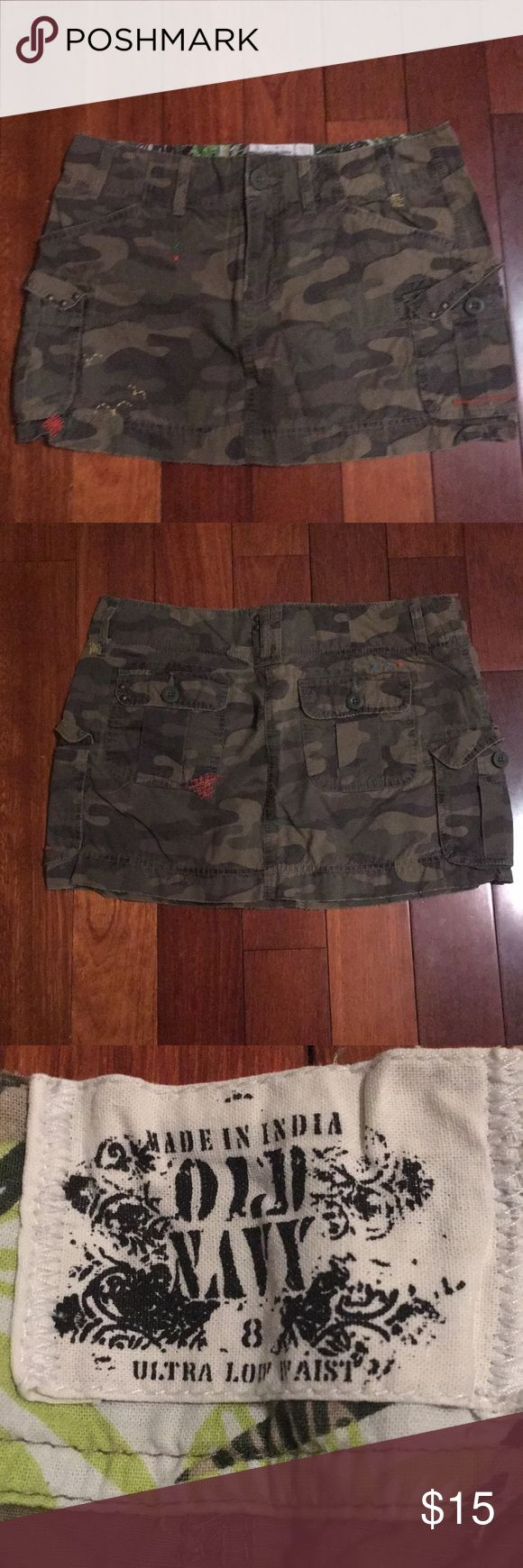 Size 8 Old Navy skirt Camo design with cargo side pockets. A few unique stitched designs and embellishment as shown in pictures. Excellent condition. Cargo type material. 100% cotton. Old Navy Skirts
