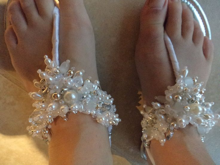 I brought a sliver pair and a black pair of broken flat sandals for $3 each. Added thick elastic through the broken loops, wrapped satin ribbon on toe hold up to elastic, then beaded. Completely over the top summer sandals, but I love them.  Would be good for flat wedding shoes.