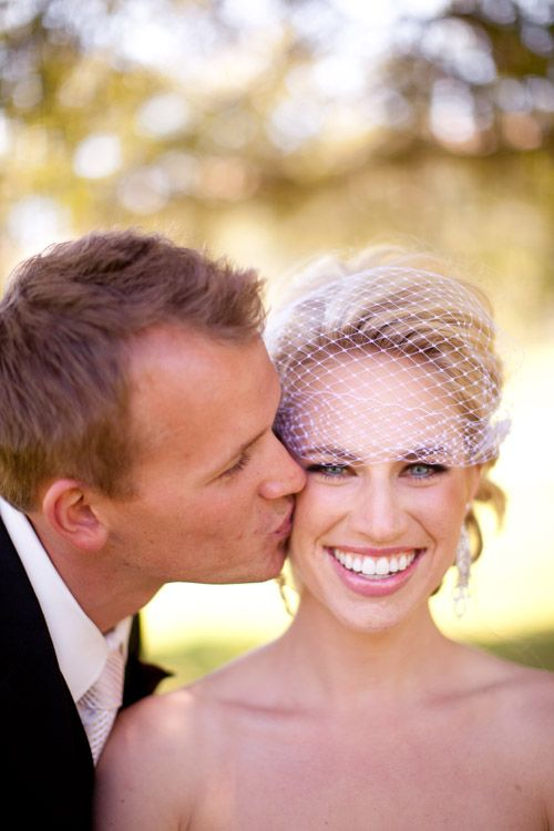 Adorable couple cutely kiss on their wedding day! photography by Breanne Schaap