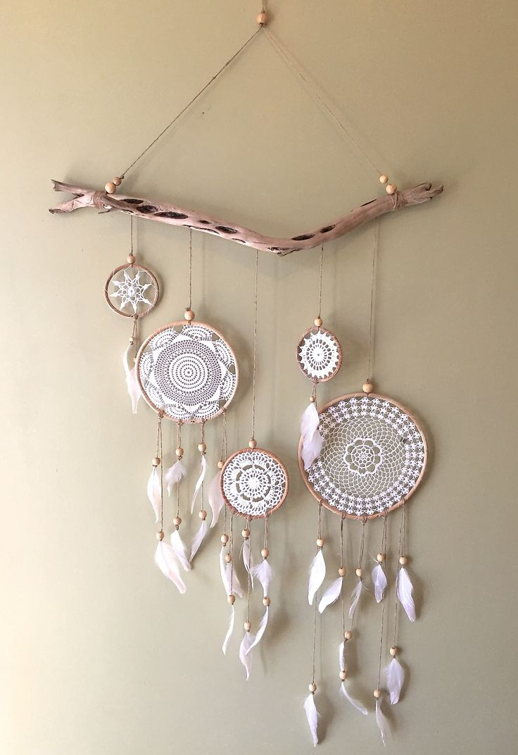 This beautiful wallhanging features 4 different size vintage doily dreamcatchers with clear crystal glitter tipped feathers on a beautiful piece of driftwood. Each piece created is unique and one of a kind, making it that little bit more special. Available