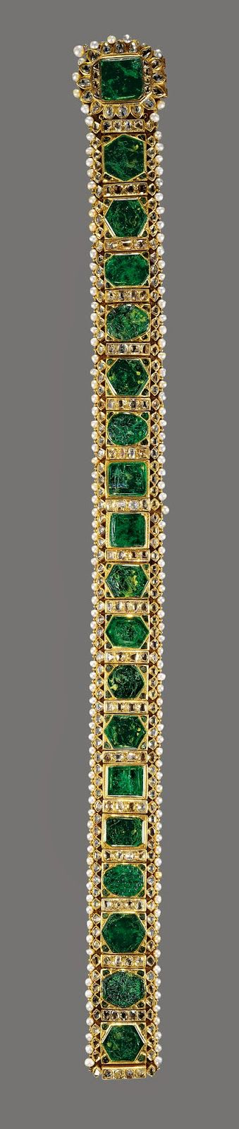 "The Lahore Emerald Girdle, c. 1840.  The emeralds in this exquisite piece were inherited by India's Maharajah Sher Singh from Ranjit Singh, his father known as the ""Lion of the Punjab.""  ""The Lion,"" it is said, had used the emeralds to decorate his horse harnesses.  The maharajah had the emeralds made into this exceptional girdle circa 1840.  Nine years later, the Directors of the East India Company obtained the belt and presented it to Queen Victoria in 1851."