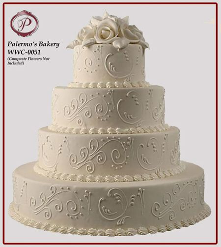Ivory Buttercream Wedding Cake with ivory scrollwork