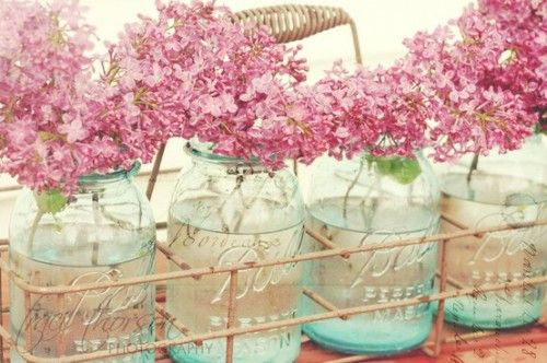 Pink Lilacs in vintage blue Ball jars.