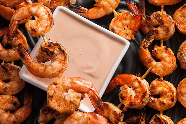An easy appetizer recipe for shrimp tossed in smoked paprika, skewered, grilled, and served with Marie Rose dipping sauce.